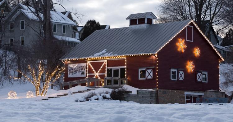 Schmanska Barn at dusk, illuminated with warm glowing lights