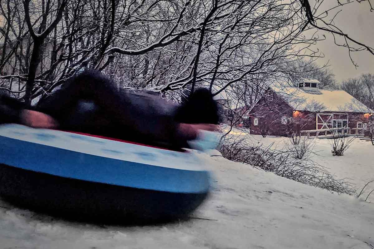 Super Dave Costa flies down the sledding hill at Schmanska Park