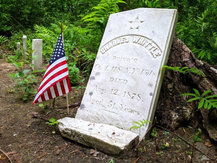 Civil War veteran's grave with American flag