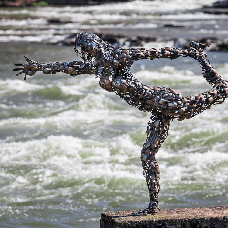 Yoga pose sculpture made of forks, spoons, and knives