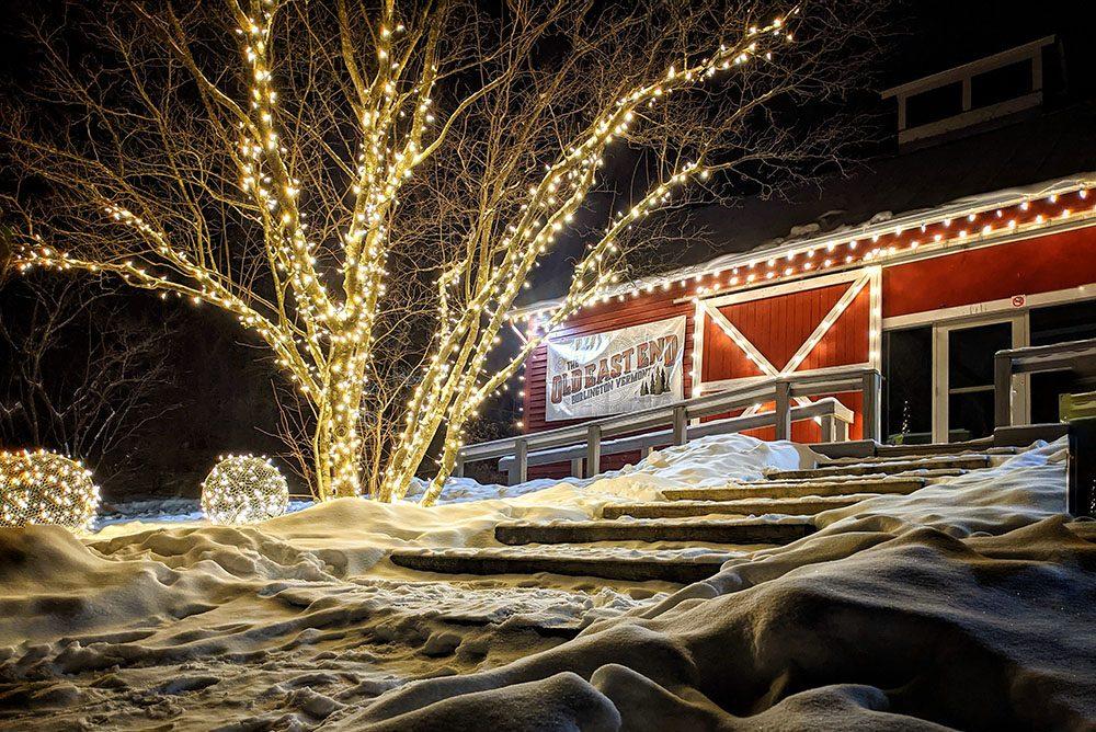 Schmanska Barn lit up on a snowy night